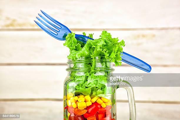 Mediterranean salad in a mason jar with handle