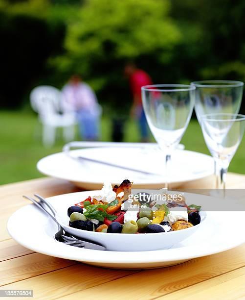 Mediterranean salad on table in garden