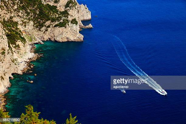 mediterranean sea from above capri cliff and ships crossing water - capri stock pictures, royalty-free photos & images