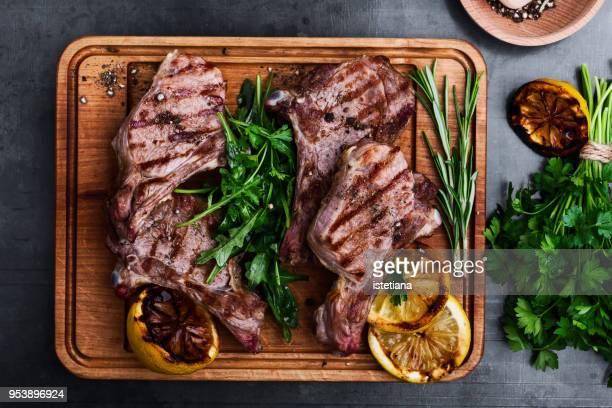 Mediterranean style grilled veal chops with fresh arugula salad