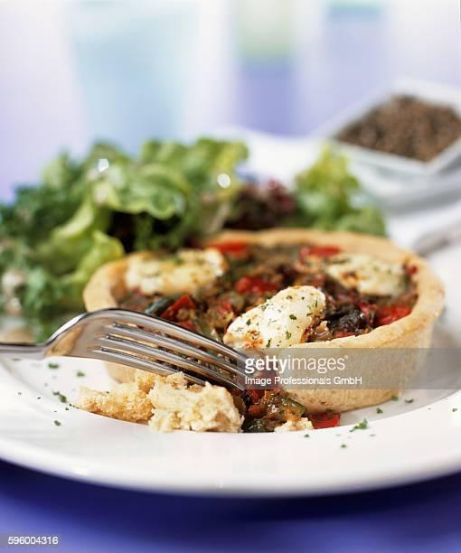 Mediterranean vegetable tart with mozzarella & salad leaves