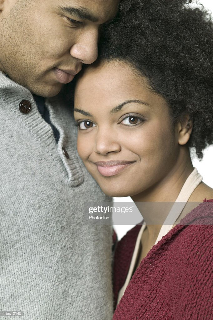 medium close up of a young adult woman as she snuggles up next to her boyfriend : Foto de stock