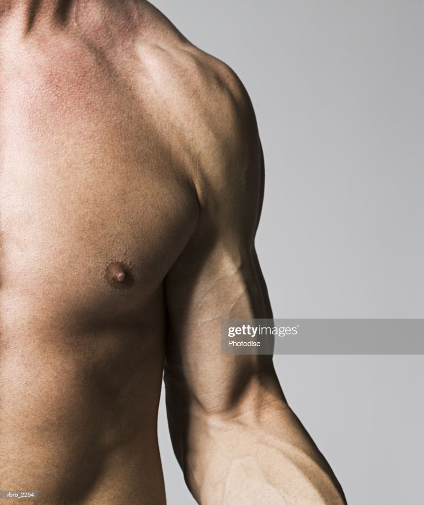 medium close up shot of the chest and arm of a male bodybuilder : Foto de stock