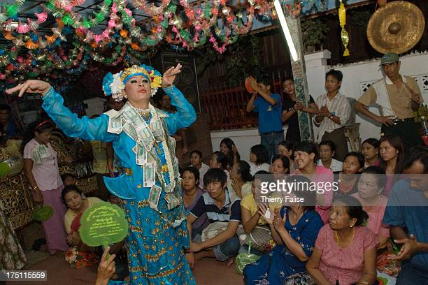 Medium dances in one of the numerous shrines dedicated to the nats during the Taungbyon nat festival. Every year in August, hundreds of thousands of...