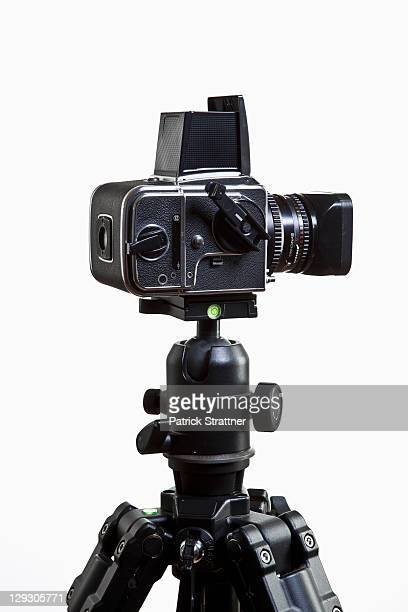 A medium format camera on a tripod, close-up