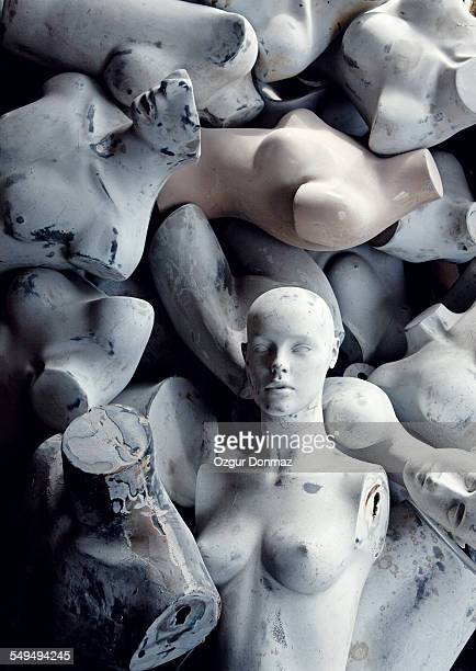 Medium group of abandoned mannequins in warehouse