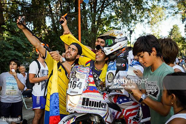 Medium Group Of People performing a selfie with BMW motorcycle competitor JORGE GOMEZ BENITEZ Spanish nationality of MARMOTOR CANARY a waterfront...
