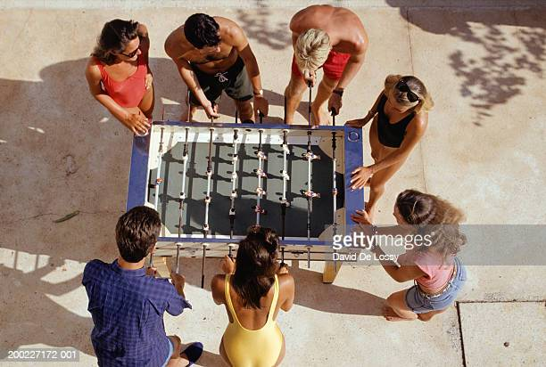 medium group of people playing foosball, overhead view - medium group of people photos et images de collection