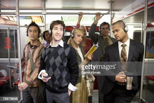 Medium Group Of People Standing In Subway Train Wearing ...
