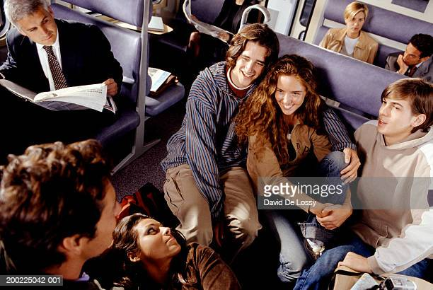 medium group of people talking on train - medium group of people photos et images de collection