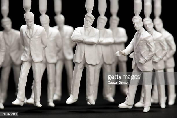 A medium group of plastic businessmen figurines