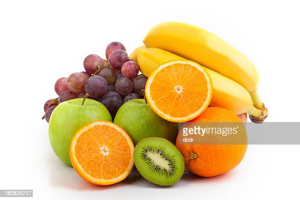 medium pile of assorted fresh and bright fruit - apple fruit stock photos and pictures