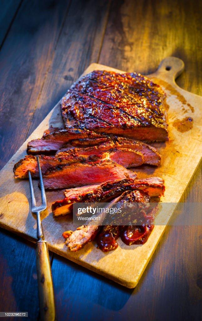 Medium rare beefsteak on wooden board : Stock Photo