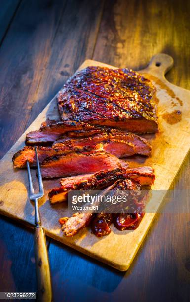 medium rare beefsteak on wooden board - barbeque sauce stock photos and pictures