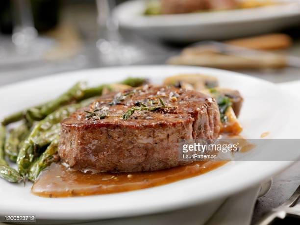 medium rare fillet mignon steak with a mushroom sauce, roasted green beans and mushrooms - steak stock pictures, royalty-free photos & images