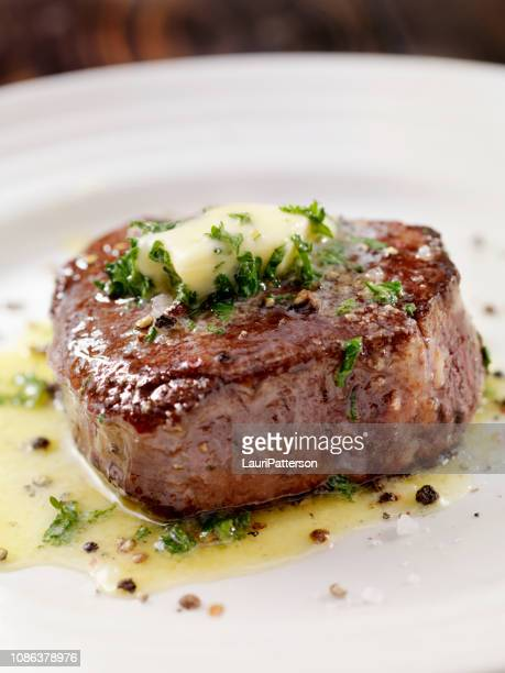 medium rare fillet mignon steak with herb garlic butter - steak stock pictures, royalty-free photos & images