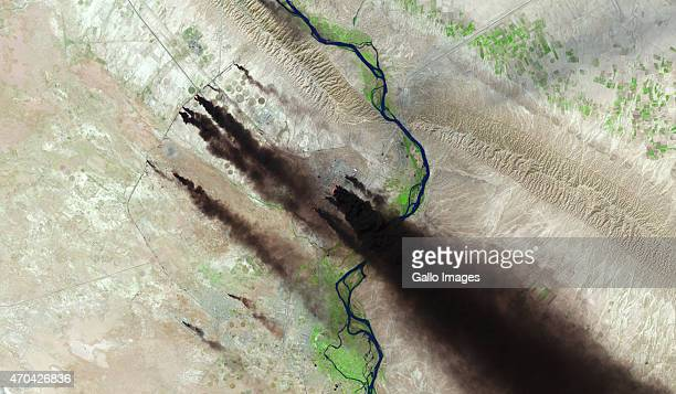 A medium Shortwave Infrared satellite view of Baiji North Oil Refinery in its latest attack extreme heat identified through bright red dots on April...