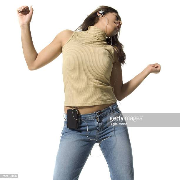 medium shot of a teenage girl as she dances while listening to headphones - personal compact disc player stock pictures, royalty-free photos & images