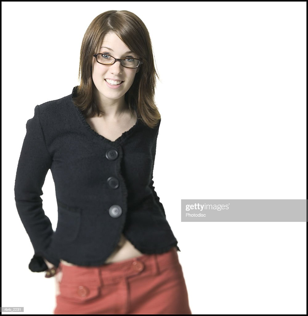 medium shot of a young adult female in a black shirt and glasses as she smiles : Foto de stock