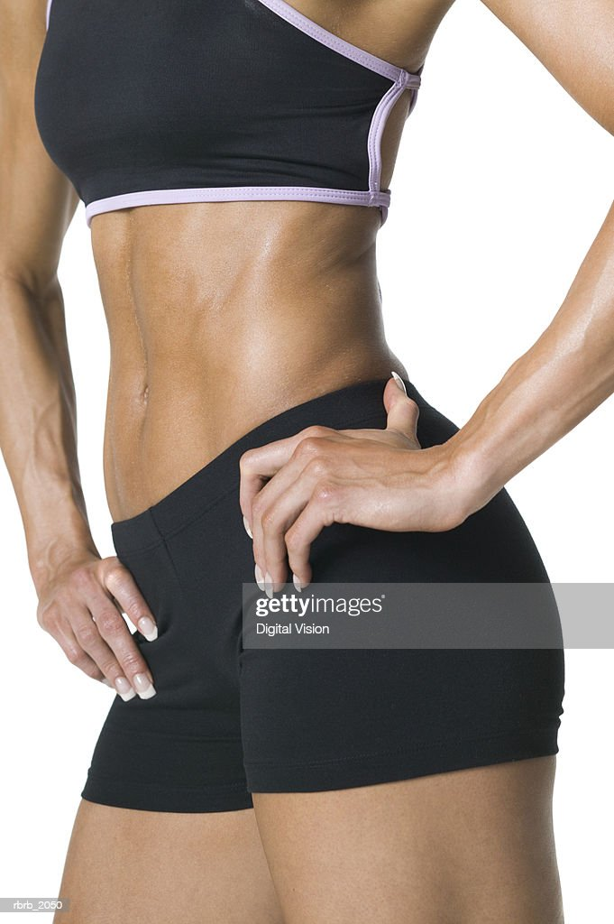 medium shot of the fit body of a young adult woman in a black workout outfit : Stockfoto