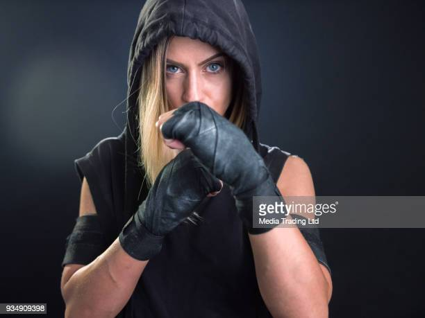 medium shot of woman mma fighter looking at camera - mixed martial arts stock pictures, royalty-free photos & images