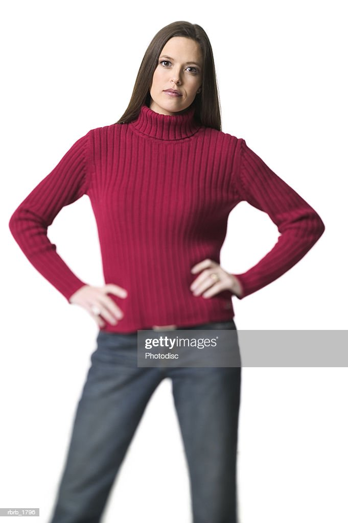 medium shot of young adult woman in red sweater has hands on her hips and looks at the camera : Bildbanksbilder