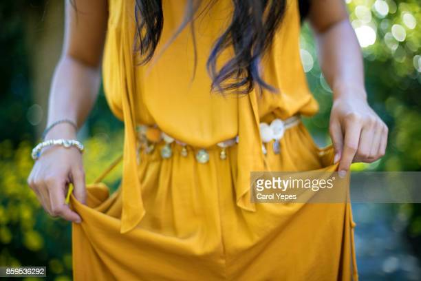 medium shot woman in yellow dress - yellow dress stock pictures, royalty-free photos & images