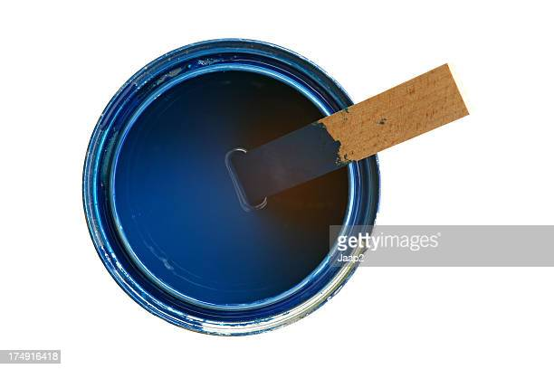 Medium sized opened can with blue paint and wooden stirrer