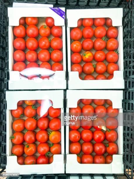 Medium sizes tomatoes in cardboard box with window