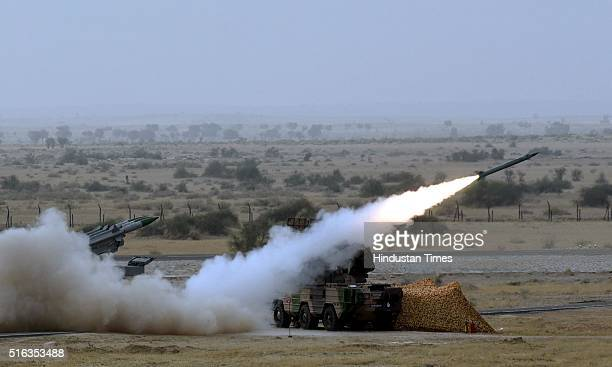 Mediumrange mobile surfacetoair Akash Missiles being fired during Indian Air Force firepower show 'Exercise Iron Fist' on March 18 2016 in the desert...