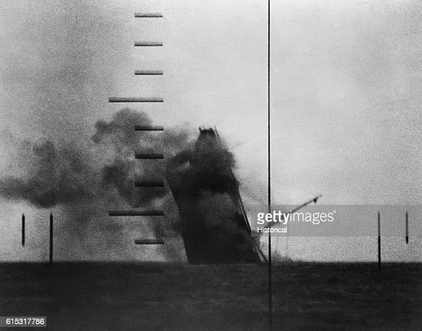 A mediumsized Japanese cargo ship sinks bowfirst almost straight down after being torpedoed by the submarine USS Wahoo under the command of Lt Cmdr...
