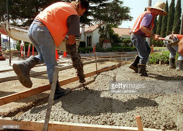 MEDivertConcreteRDL Workers from All American Asphalt pour a new concrete sidewalk at the corner of Santa Clara Ave and Broadway in Santa Ana where...