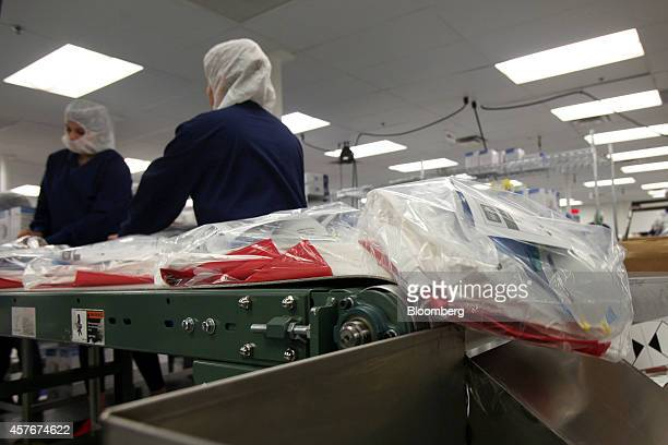 Medline Industries Personal Protection Equipment kits move down a conveyer belt before being shipped out to various health facilities at their...