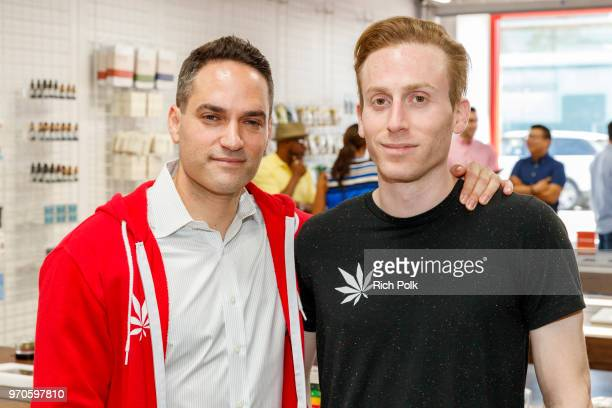 MedMen CEO and CoFounder Adam Bierman and MedMen President and CoFounder Andrew Modlin pose for a photo at the MedMen Abbot Kinney store ribbon...