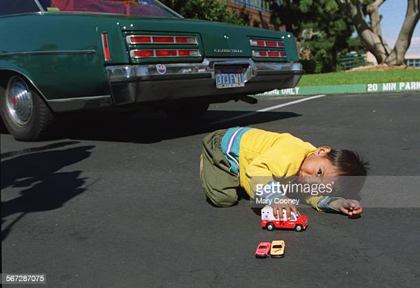 MEDonate0220MC––Roberto Serrano 2 years old playing with toy cars and a toy ambulance next to the real car a Grand Villa that was donated his family...