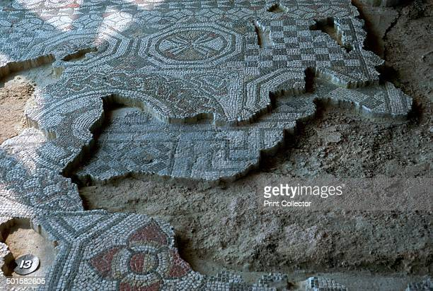 Medusa-head mosaic laid over an earlier black and white mosaic floor, at Fishbourne Roman palace, 3rd century.