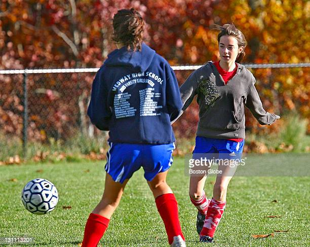 Medway HS Rory Cellucci left and Jenny Russo right face off during soccer practice at Medway High School Wednesday October 25 2006