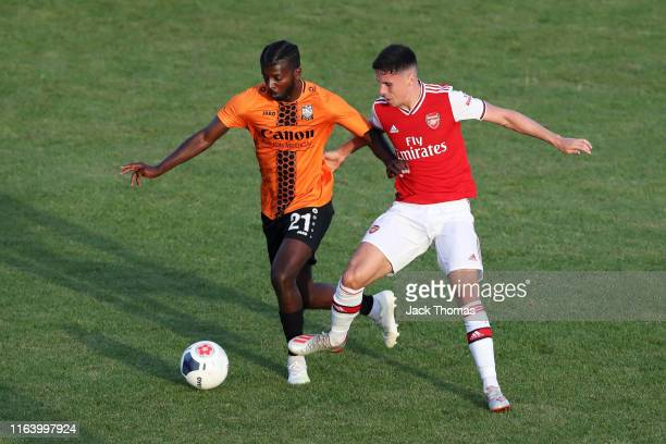Medy Elito of Barnet battles for possession with Jordan McEneff of Arsenal during the PreSeason Friendly match between Barnet and Arsenal at The Hive...