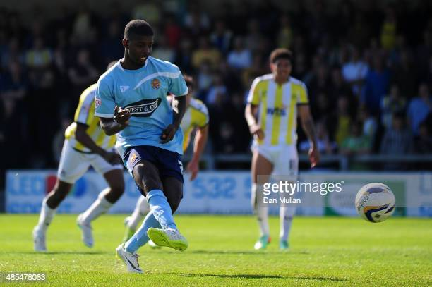 Medy Elito of Dagenham & Redbridge scores the opening goal from the penalty spot during the Sky Bet League Two match between Torquay United and...