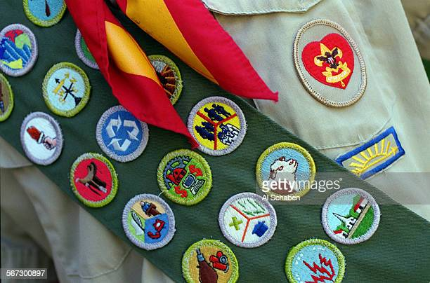MEeaglejohnson20809AS––TUSTIN––Aaron Johnson who was awarded the Boy Scout's highest honor Eagle Scout shows off his merit badge sash at his Tustin...