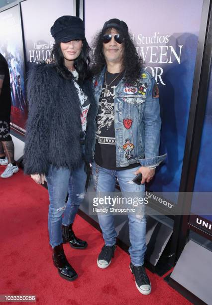Meegan Hodges and Slash attend Halloween Horror Nights 2018 at Universal Studios Hollywood on September 14 2018 in Los Angeles California