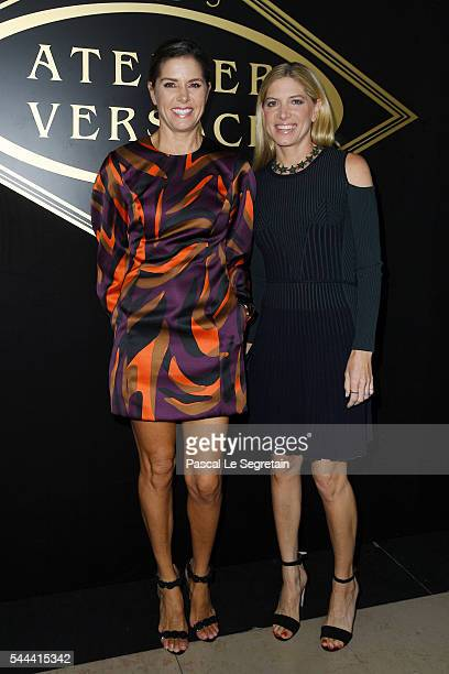 Meehan O'Neill and Petra Flannery attend the Atelier Versace Haute Couture Fall/Winter 20162017 show as part of Paris Fashion Week on July 3 2016 in...