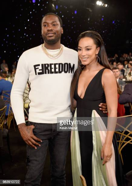 Meek Mill and Angela Rye attend the 2018 NBA Awards at Barkar Hangar on June 25 2018 in Santa Monica California