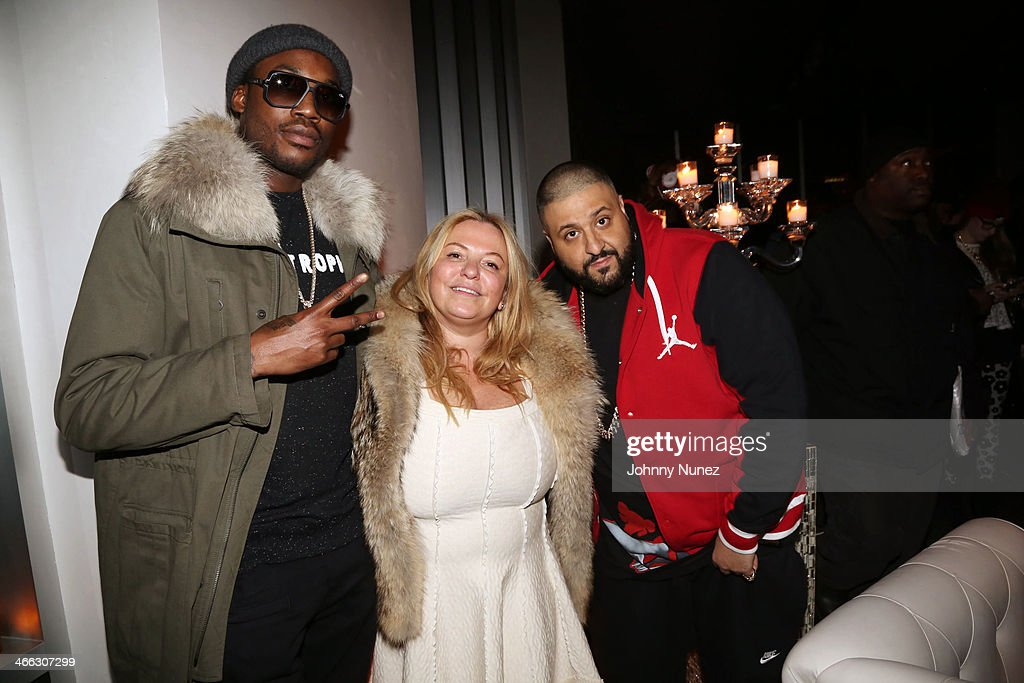 Meek Mill (L) and DJ Khaled (r) pose for a picture with Just Ivy's mother during the Just Ivy Private Showcase at The Glasshouses on January 31, 2014 in New York City.