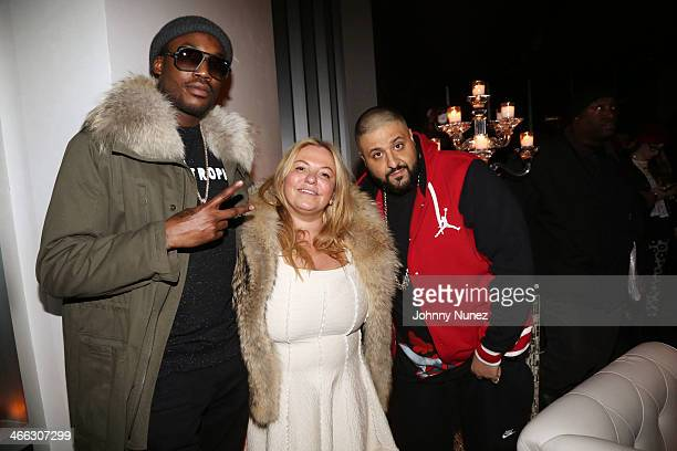Meek Mill and DJ Khaled pose for a picture with Just Ivy's mother during the Just Ivy Private Showcase at The Glasshouses on January 31 2014 in New...