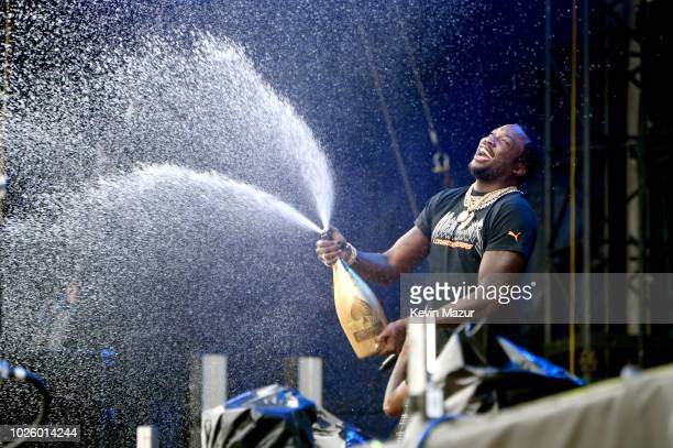 Meek Mill opens a bottle of D'usse onstage during the 2018 Made In America Festival Day 1 at Benjamin Franklin Parkway on September 1 2018 in...
