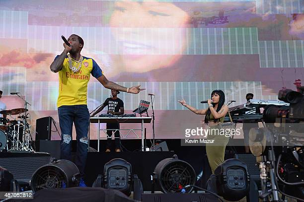 Meek Mill performs with surprise guest Nicki Minaj onstage during the 2015 Budweiser Made in America Festival at Benjamin Franklin Parkway on...