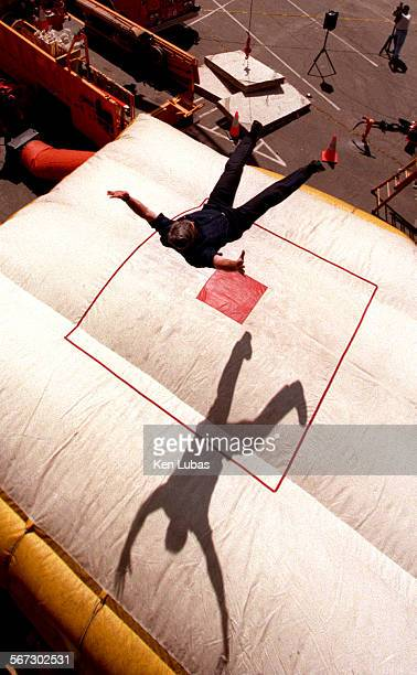 MEEmergFair24/11KL––Los Angeles City Firefighter Don Carlson out of station 66 in the Crenshaw District cast shadow on airbag as he leaps from...