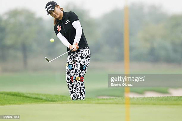Meena Lee of South Korea hits her approach shot during the second round of the Reignwood LPGA Classic at Pine Valley Golf Club on October 4 2013 in...