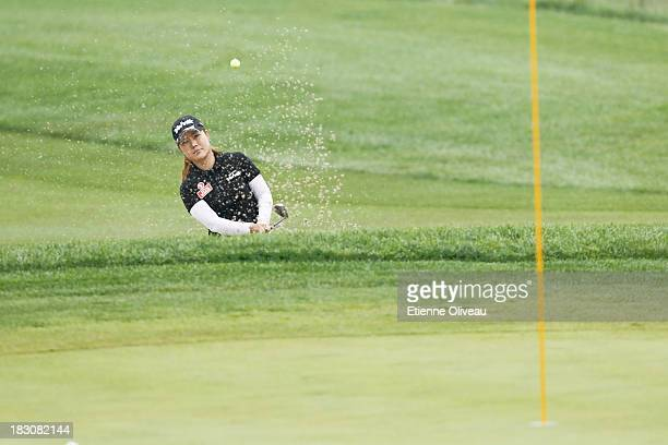 Meena Lee of South Korea hits out of a bunker during the second round of the Reignwood LPGA Classic at Pine Valley Golf Club on October 4 2013 in...